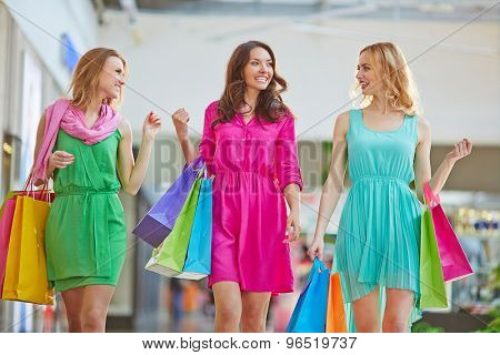 Glamorous girls talking while spending leisure in the mall