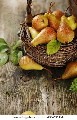 Ripe pears in a basket