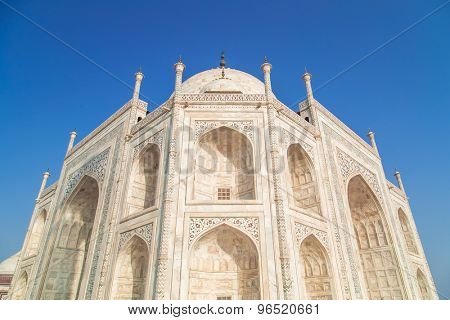 Top view of South-East side of Taj Mahal on blue sky.