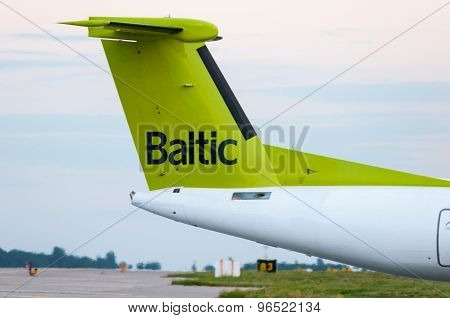 KIEV, UKRAINE - JULY 10, 2015:  The tail of the aircraft Air Baltic propeller airplane taxis to temi