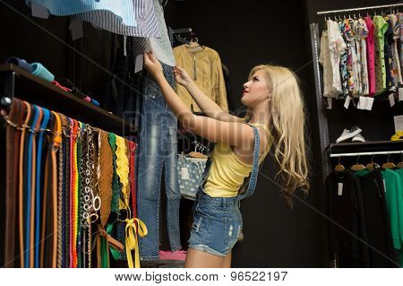 Happy woman shopping in clothing store