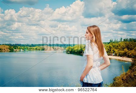 Woman at cliff above the river