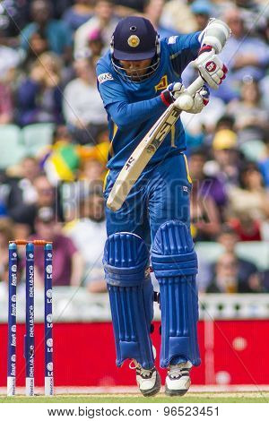 LONDON, ENGLAND - June 17 2013: Sri Lanka's Mahela Jayawardene gets hit on the hand during the ICC Champions Trophy international cricket match between Sri Lanka and Australia.