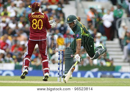 LONDON, ENGLAND - June 07 2013: Pakistan's Wahab Riaz runs a single during the ICC Champions Trophy cricket match between Pakistan and The West Indies at The Oval Cricket Ground.