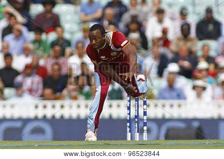 LONDON, ENGLAND - June 07 2013: West Indies Kemar Roach bowling during the ICC Champions Trophy cricket match between Pakistan and The West Indies at The Oval Cricket Ground.