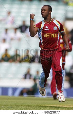 LONDON, ENGLAND - June 07 2013: West Indies Kemar Roach celebrates taking the wicket of Pakistan's Imran Farhat during the ICC Champions Trophy cricket match between Pakistan and The West Indies
