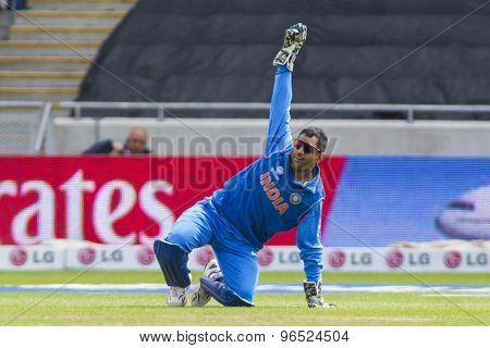 EDGBASTON, ENGLAND - June 15 2013: India's Mahendra Singh Dhoni appeals for the wicket of Asad Shafiq during the ICC Champions Trophy match between India and Pakistan at Edgbaston Cricket Ground.