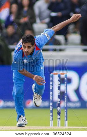 EDGBASTON, ENGLAND - June 15 2013: Pakistan's Bhuvneshwar Kumar bowling during the ICC Champions Trophy cricket match between India and Pakistan at Edgbaston Cricket Ground.