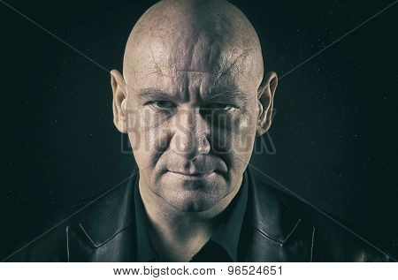 Bald man with serious expression - space stars background