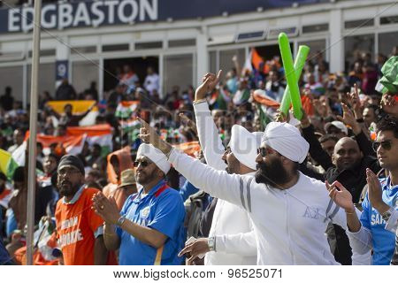 EDGBASTON, ENGLAND - June 15 2013: Indian fans signal four runs during the ICC Champions Trophy cricket match between India and Pakistan at Edgbaston Cricket Ground.