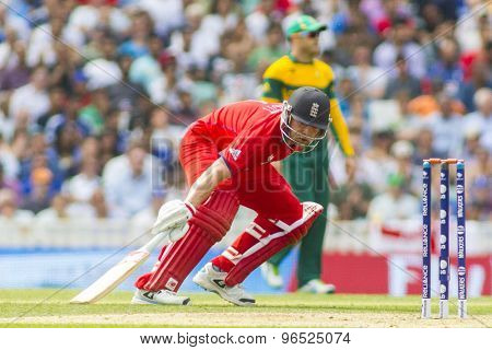 LONDON, ENGLAND - June 19 2013: Sweat pours from Jonathan Trott's helmet as he runs a single during the ICC Champions Trophy semi final between England and South Africa at The Oval Cricket Ground