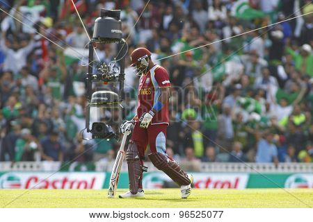 LONDON, ENGLAND - June 07 2013:Spidercam follows Darren Bravo as he walks off after being dismissed during the ICC Champions Trophy cricket match between Pakistan and The West Indies