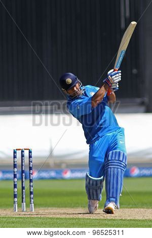 CARDIFF, WALES - June 04 2013: India's Mahendra Singh Dhoni hits a six off the bowling of Australia's Shane Watson during the ICC Champions Trophy warm up match between India and Australia