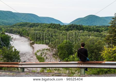 Man Gazing Out To The Hills And Mountains In Cape Breton