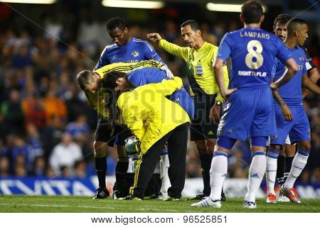 LONDON, ENGLAND. September 19 2012 Chelsea's Brazilian midfielder Oscar  gets treatment from the physios  during the UEFA Champions League football match between Chelsea and Juventus