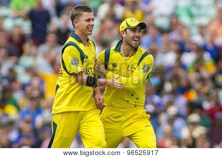 LONDON, ENGLAND - June 17 2013: Australia's Xavier Doherty, and Glenn Maxwell celebrate taking the wicket of Tillakaratne Dilshan during the ICC Champions Trophy match between Sri Lanka and Australia.