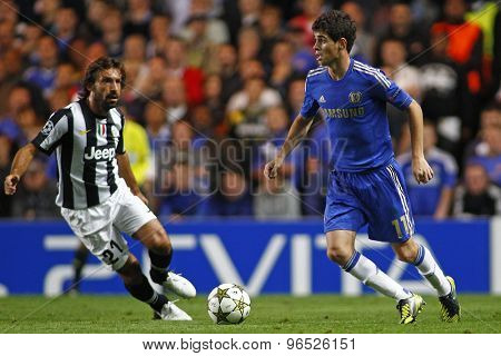 LONDON, ENGLAND. September 19 2012 Juventus's Italian midfielder Andrea Pirlo  and Chelsea's Brazilian midfielder Oscar during the UEFA Champions League football match between Chelsea and Juventus