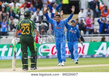 EDGBASTON, ENGLAND - June 15 2013: Indias Umesh Yadav appeals for a wicket during the ICC Champions Trophy cricket match between India and Pakistan at Edgbaston Cricket Ground.