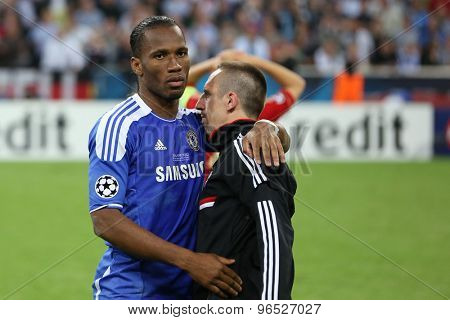 MUNICH, GERMANY May 19 2012. Chelsea's Ivory Coast forward Didier Drogba consoles Bayern's French midfielder Franck Ribery after Chelsea win the 2012 UEFA Champions League Final at the Allianz Arena