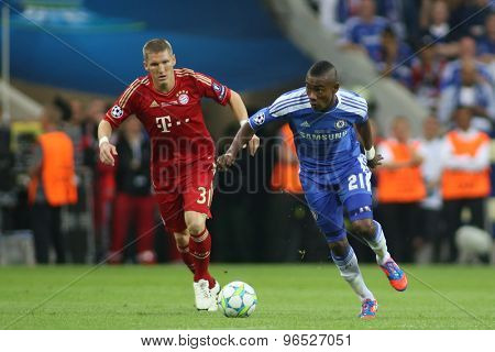 MUNICH, GERMANY May 19 2012. Bayern's German midfielder Bastian Schweinsteiger  and Chelsea's Ivory Coast forward Salomon Kalou in action during the 2012 UEFA Champions League Final