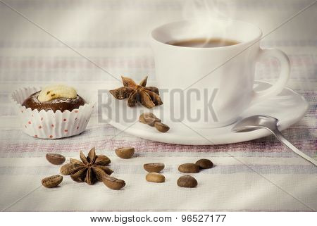 Cup of coffee with fresh almond cakes
