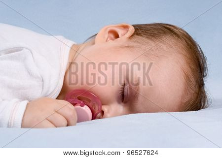 Close-up Portrait Of A Beautiful Sleeping Baby On Blue Blanket. Use The Photo To Represent Life, Par