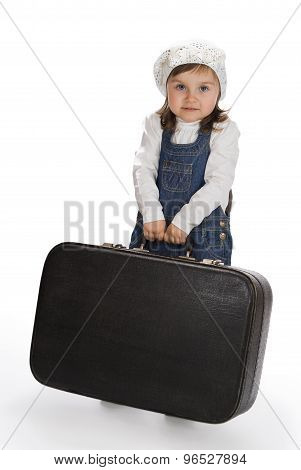Little Girl Pulling A Heavy Suitcase