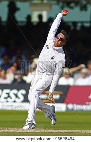 LONDON, ENGLAND. AUGUST 19 2012 England's Graeme Swann bowling during the third Investec cricket  test match between England and South Africa, at Lords Cricket Ground