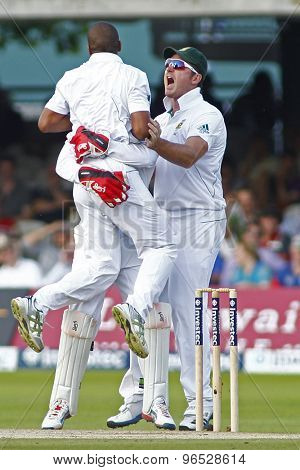 LONDON, ENGLAND. AUGUST 19 2012 South Africa's Vernon Philander jumps into the arms of South Africa's Graeme Smith during the third Investec cricket  test match between England and South Africa