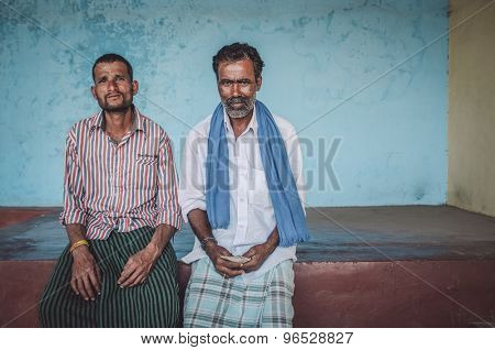 KAMALAPURAM, INDIA - 02 FABRUARY 2015: Indian men sit under a covered space on a market close to Hampi. Post-processed with grain, texture and colour effect.