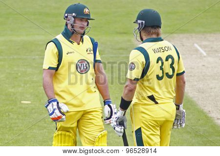 CHESTER LE STREET, ENGLAND. JULY 07 2012: Australia's Peter Forrest, and Australia's Shane Watson, discuss if they should review  during the 4th one day international between England and Australia