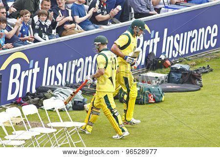 CHESTER LE STREET, ENGLAND. JULY 07 2012: Australia's David Warner, walks off past Australia's Peter Forrest, during the 4th one day international between England and Australia