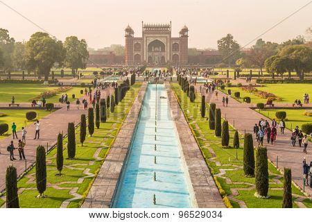 AGRA, INDIA - 28 FEBRUARY 2015: View of North side of Great Gate from Taj Mahal with visitors.