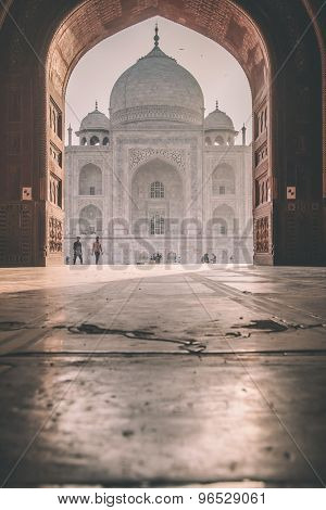 AGRA, INDIA - 28 FEBRUARY 2015: View of Taj Mahal from mosque. West side. Post-processed with grain, texture and colour effect.