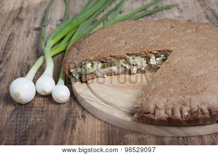 Pie With Green Onions And Egg In The Dough Of Rye Flour.