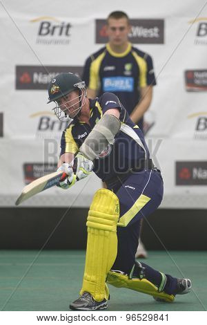 CHESTER LE STREET, ENGLAND. JULY 06 2012: Australia's Brett Lee, batting whilst on a tensioned leash held by the Australian team masseuse during the official training and net session