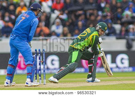 EDGBASTON, ENGLAND - June 15 2013: Pakistan's Misbah-ul-Haq is bowled during the ICC Champions Trophy cricket match between India and Pakistan at Edgbaston Cricket Ground.