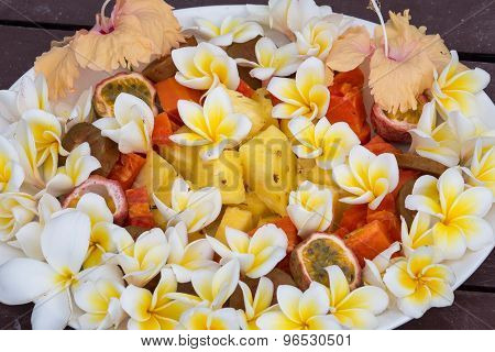 Fruit Dessert Salad With Pineapple, Papaya, Passion Fruit, And White Frangipani Flower