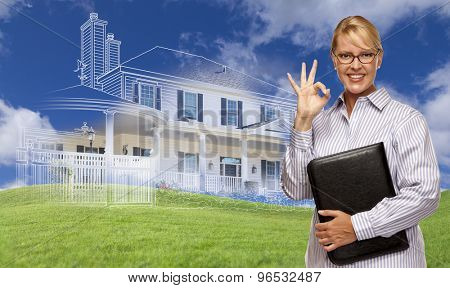Businesswoman Making Okay Hand Sign with Ghosted House Drawing, Partial Photo and Rolling Green Hills Behind.
