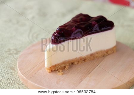Blueberry cheese cake on wood plate