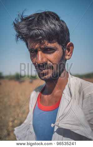 GODWAR REGION, INDIA - 14 FEBRUARY 2015: Young Rabari tribesman with no turban. Post-processed with grain, texture and colour effect.