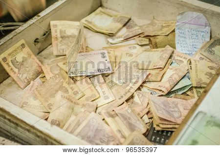 MUMBAI, INDIA - 05 FEBRUARY 2015: Desk drawer full of Indian rupees mostly with 10 rupee notes.