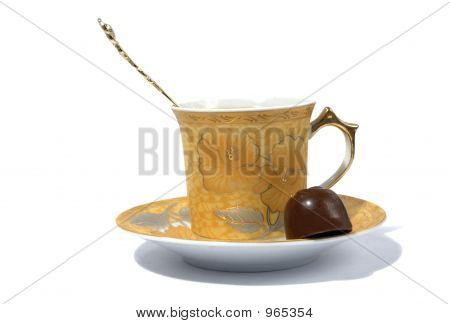Cup, Spoon And Chocolate On Saucer