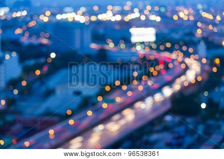 Abstract blurred bokeh city road curved at night