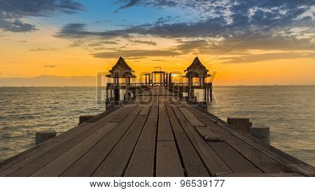 Wooden Bridge and Pavilion into sea during sunset