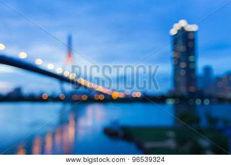 Abstract blurred bokeh light, the bridge river front view twilight