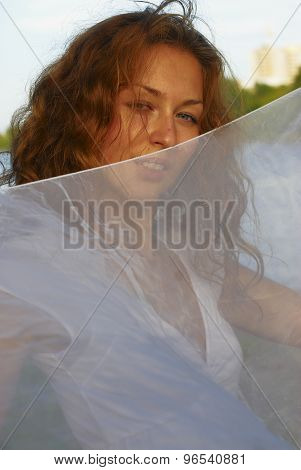 Young pretty woman with white scarf