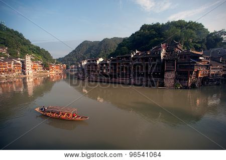 Tourist boat on river In Fenghuang Ancient City.