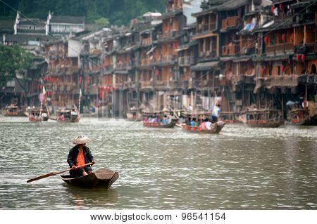 People Paddle On The River Every Day In Fenghuang Ancient City.