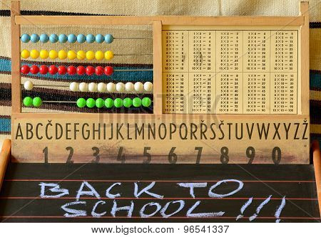 Back to school. Abacus blackboard alphabet and numbers.